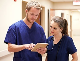 Blog_HealthcareHandoffs_MedProfTabletDocs2talkScrubs_260x200px.jpg