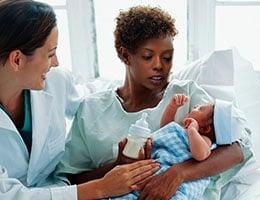Blog_MaternalMortality5Strategies_BabyNewbornDepressedMotherHospitalHoldBottleDoctor_260x200px